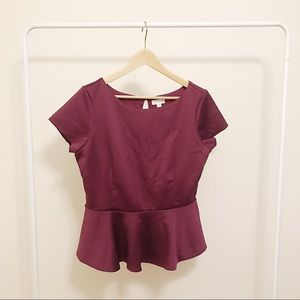 Purple peplum top.